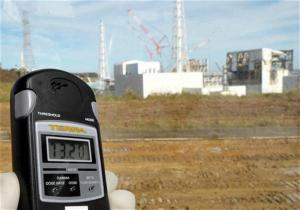 A radiation monitor indicates 73.20 microsieverts per hour at the site of the crippled Fukushima Daiichi nuclear plant in Fukushima